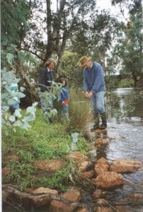 Rupert Richardson and family on new rock riffle on Serpentine River circa 2000